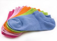 Rainbow of Short Ankle Socks--Isolated. Colorful display of five pairs of short ankle/athletic socks (no-show), splayed in a fan arrangement.  Colors are blue Stock Photos