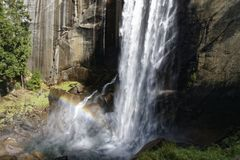 Vernal Fall Rainbow. A rainbow is showing in Yosemite`s Vernal Fall Royalty Free Stock Photography