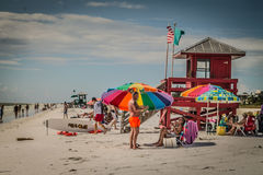 Rainbow at Siesta Key Beach. Beachgoers enjoy the summer sun along Siesta Key in Florida royalty free stock photography