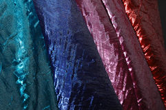 Rainbow Silk. Bolts of shiny crushed taffeta fabric Royalty Free Stock Photography
