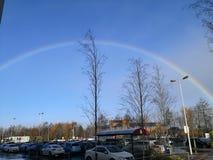 Rainbow over car park Royalty Free Stock Image