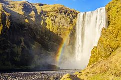 Rainbow at Skogafoss waterfall Iceland Stock Photo