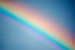 Rainbow in the sky. Colour rainbow in the blue sky royalty free stock image