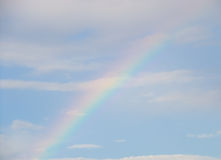 Rainbow in sky. Arc of rainbow in blue sky with cloudscape Royalty Free Stock Photos
