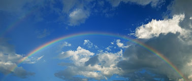 Rainbow with sky and clouds panorama Stock Images