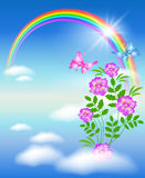 Rainbow in the sky and flowers Stock Photography