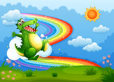 A rainbow in the sky with a green crocodile Stock Images