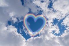 Rainbow in the sky. Heart shape rainbow in the sky Royalty Free Stock Image
