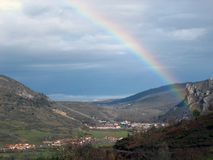 Rainbow, Sky, Highland, Meteorological Phenomenon stock photo