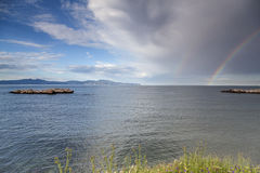 Rainbow sky landscape. Rainbow and cloudy sky at an idylic place Royalty Free Stock Photography