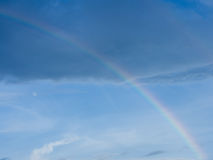 Rainbow. In the sky with the moon after rain before sunset Royalty Free Stock Photography
