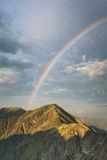 Rainbow on the sky over the mountains peaks in Romania.  royalty free stock photography