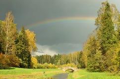 The rainbow in the sky after the rain. A beautiful rainbow appeared in the sky after the rain Stock Photos