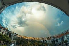 Rainbow at sky after the rain. Stock Photos
