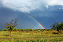 Rainbow in the sky after the storm. Natural wonder rainbow in the sky after the storm Royalty Free Stock Photo