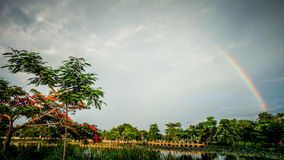 Rainbow with sky. Sunset  with lagoon in Ratchaburi Thailand Royalty Free Stock Photo