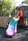 Rainbow slide on the playground Stock Images