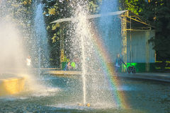 Rainbow in the small fontain at bright sunny day Stock Images