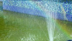 Rainbow in small fountain stock video