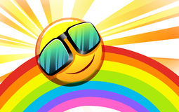 A rainbow with a smiling sun Stock Photo