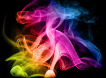 Rainbow smoke. Smoke in the maelstrom of the rainbow on a black background Royalty Free Stock Image