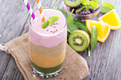 Rainbow smoothie with berries and fruits Royalty Free Stock Photo