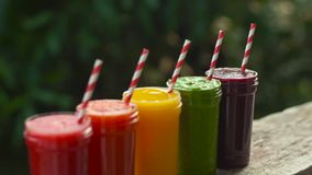 Rainbow from smoothies. Watermelon, papaya, mango, spinach and dragon fruit. Smoothies, juices, beverages, drinks. Variety with fresh fruits on a wooden table stock video