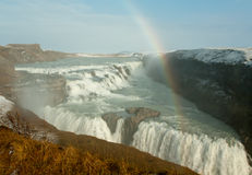 Rainbow and snow at gullfoss cascade Royalty Free Stock Photography
