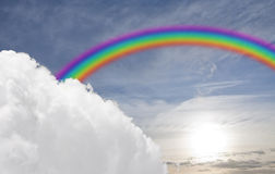 Rainbow, sole e nube Immagine Stock