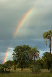Rainbow sopra il paesaggio tempestoso Fotografie Stock