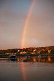 Rainbow on Southwest harbor. This was an incredible scene, walking out on the boat docks viewing the sunrise when I turned around it gave me chills. The bright stock photos