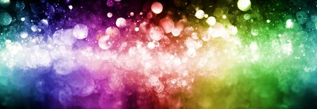 Rainbow of sparkling glittering lights abstract Stock Images