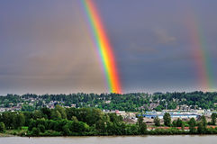 Rainbow spearing up to the sky on the hilltop Royalty Free Stock Photos