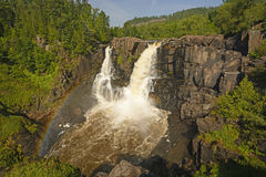 Rainbow by Spectacular Falls in the Summer Stock Photo