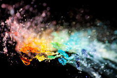 Rainbow Splash. Colorful drops exploding in air Royalty Free Stock Photo