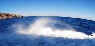 Rainbow, splashing, waves Royalty Free Stock Images