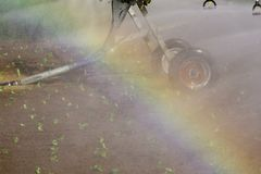 Rainbow by spray irrigation system Stock Photos