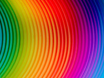 Rainbow spring colours. Close up of a plastic rainbow spring Stock Images