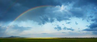 Rainbow in spring season Stock Images