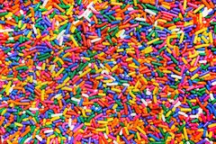 Rainbow sprinkles background Royalty Free Stock Photography