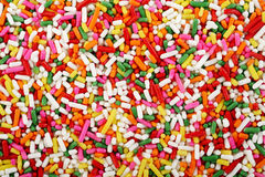 Rainbow sprinkles background Royalty Free Stock Photos