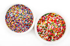 Rainbow sprinkles in cup. Rainbow sprinkles in white cup Stock Image