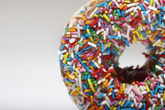 Rainbow sprinkles on doughnut Royalty Free Stock Images