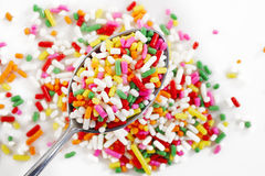 Rainbow sprinkles in spoon Stock Photography
