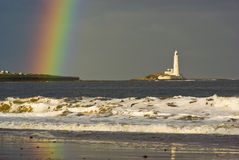 Rainbow at St. Marys Lighthouse near Newcastle Stock Photo