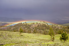 Rainbow in Storm Stock Image