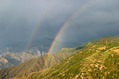 Rainbow after the storm. In the mountains of Kings Canyon National Park royalty free stock photo
