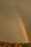 Rainbow after storm. Beautyful colorful rainbow after storm, dark sky Royalty Free Stock Photos