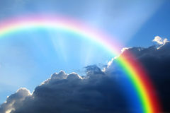 Rainbow storm cloud. Photo of storm clouds with arc rainbow ideal for background or own text Stock Photo