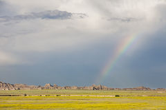 Rainbow. And storm clouds over Badlands National Park, South Dakota, USA stock image